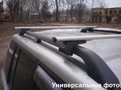Багажник на рейлинги для Geely Emgrand X7 '13-, аэродинамический стальной, сквозной (Десна-Авто)