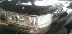 Защита фар c LED для Toyota Land Cruiser 200 с 2015, прозрачная 2 шт (EGR)