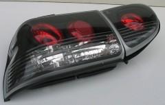 Фото 3 - Фонари задние для Ford Escort '95-00, черные (ASP)